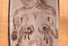 "Swallowed a Drop or Two, 2002, hand-sewn human hair & graphite on mylar in 3-layer resin, 10"" x 6"","