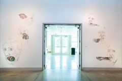 Normative Discontent, 2019, conte and specialty fabric on wall, drawing installation at Fort Lewis College, both wall drawings together are 12' x 22'